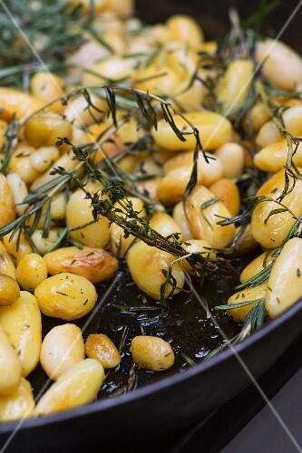 Rosemary potatoes in a pan (detail)