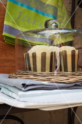 Cakes under a glass cloche