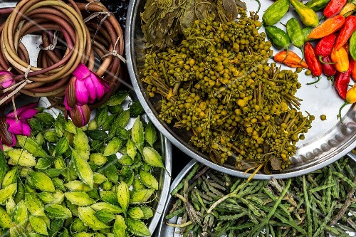 Exotic fruits, lotus flowers and vegetables on a market stand in Yangon, Myanmar