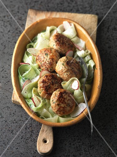 Veal meatballs on a cucumber and radish salad