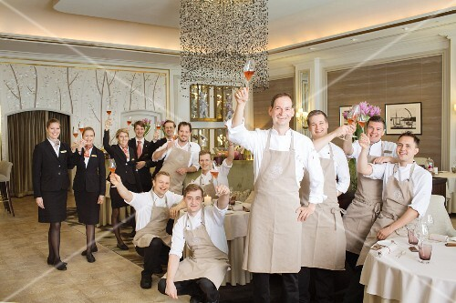 A group photo of the waiting and kitchen staff of the Haerlin restaurant in the Fairmont Hotel Vier Jahreszeiten, Hamburg