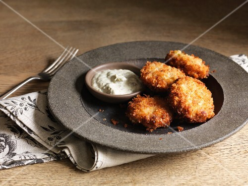 Crispy fish cakes with a dip