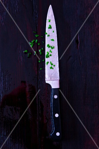 Snipped chives with knife