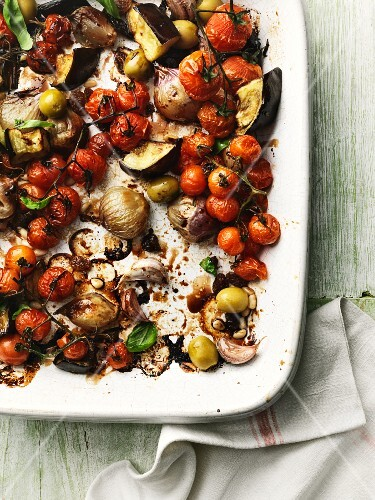 Oven roasted vegetables on a rectangular ceramic platter