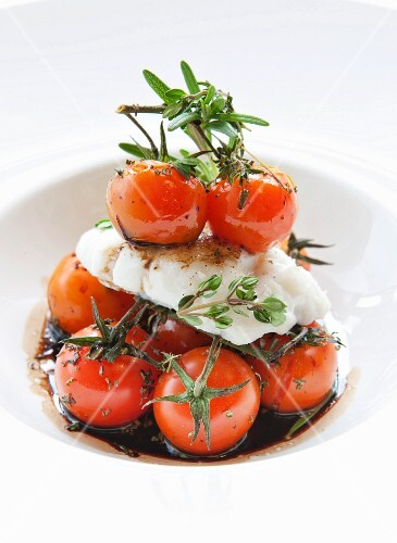 Cod with baked cherry tomatoes in a balsamic sauce