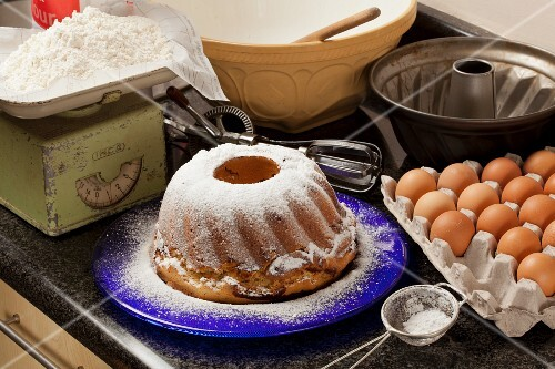 Marble cake with icing sugar and baking ingredients