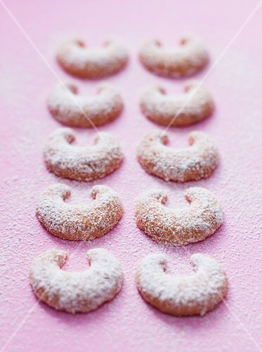 Two rows of vanilla crescent biscuits dusted with icing sugar