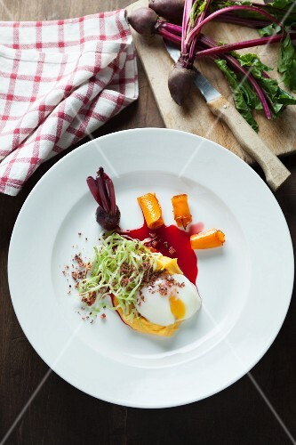 A poached egg with beetroot sauce
