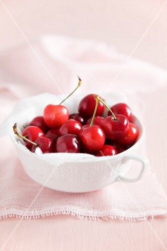 A cup of fresh cherries