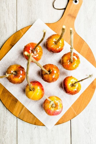 Toffee apples on a piece of baking paper