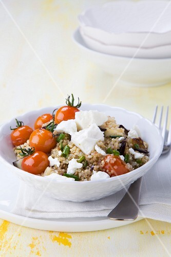 Quinoa salad with aubergines, cherry tomatoes and feta cheese