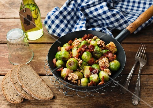 Fried Brussels sprouts with bacon and walnuts