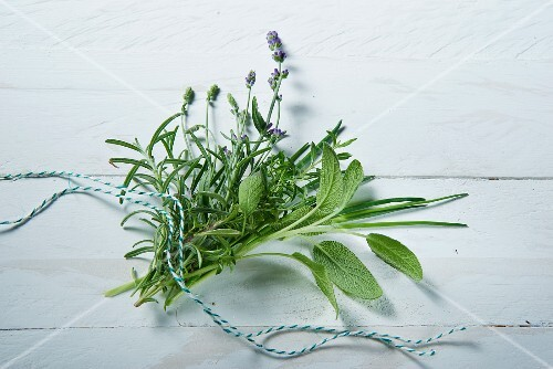A fresh bunch of herbs featuring sage, rosemary, lavender, chives and savory