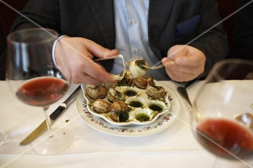 A man eating snails