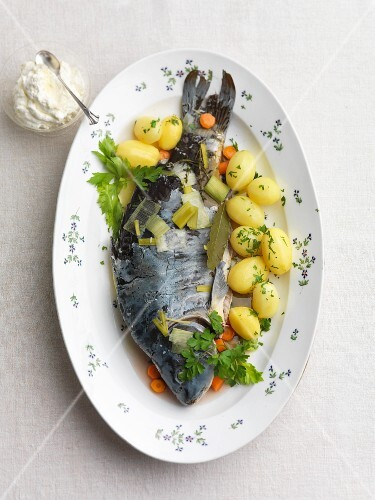 Poached carp with parsley potatoes
