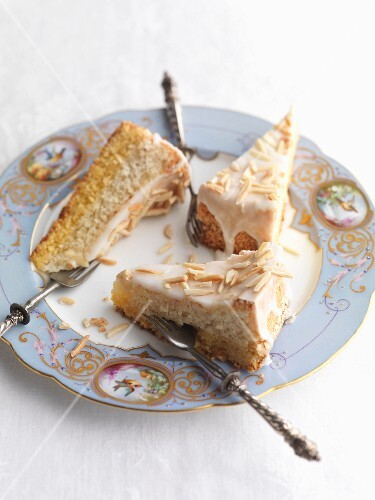 Three slices of almond cake with icing