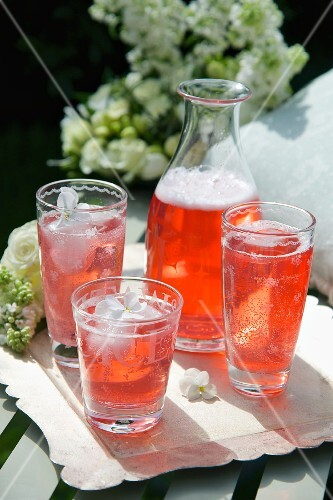 Refreshing Aperol drinks in glasses and a carafe