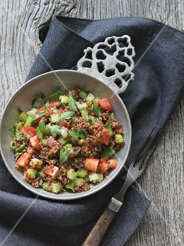 Quinoa salad with cucumber, tomato and coriander