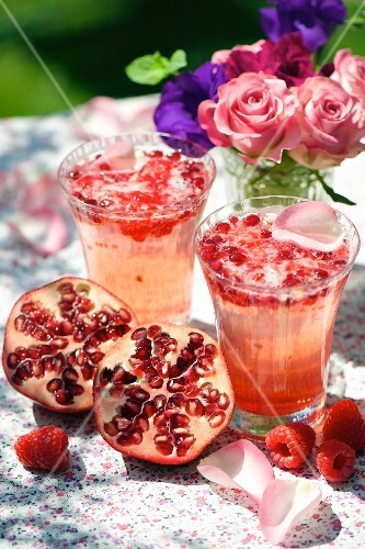 Rose and pomegranate drink with raspberry syrup