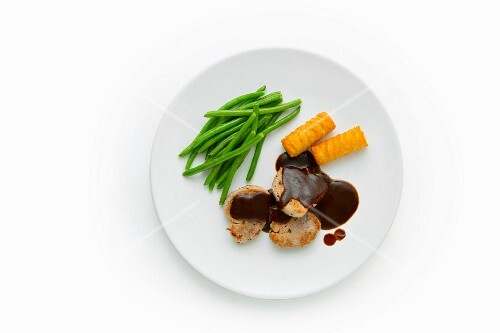 Pork medallions with carob sauce, green beans and potato croquettes