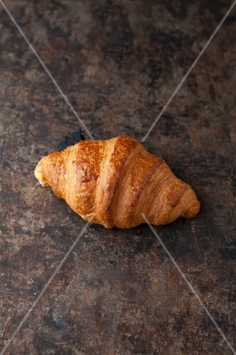 A butter croissant on a baking tray