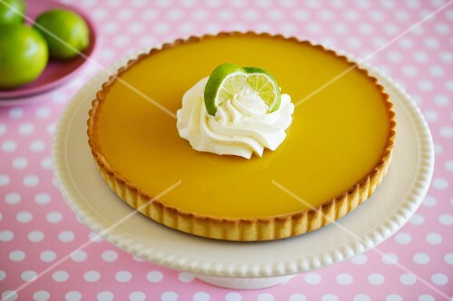 Lemon curd tart on a cake stand