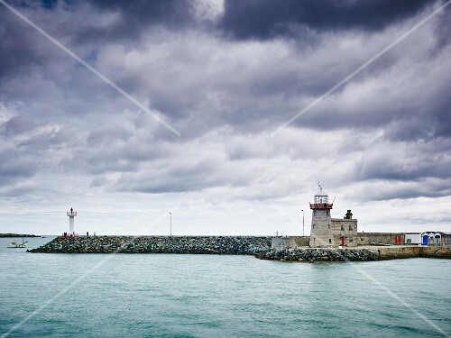 The harbour wall and light tower in Howth (Dublin, Ireland)