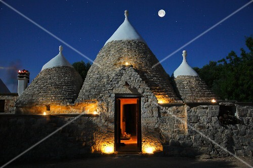 Trulli houses in Ostuni by night (Brindisi, Italy)