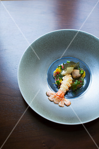 A langoustine seasoned with yuzu and dashi