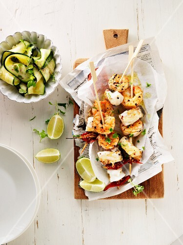 Seafood skewers with courgette salad