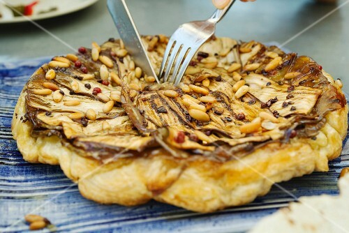Aubergine tarte tatin with pine nuts and cocoa beans
