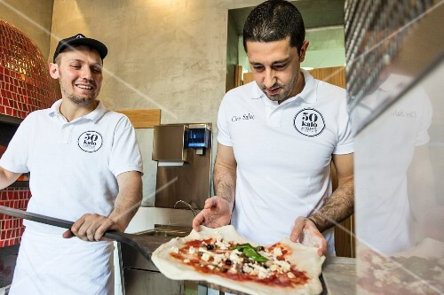 Pizza bakers in the Pizzeria 50 Kalo (Naples, Italy)