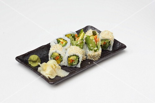 Maki with avocado and vegetables served with ginger and wasabi (Japan)