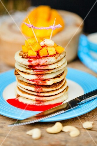 Gluten-free pancakes with mango and cashew nuts