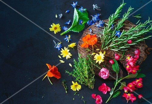 Various fresh herbs and edible flowers