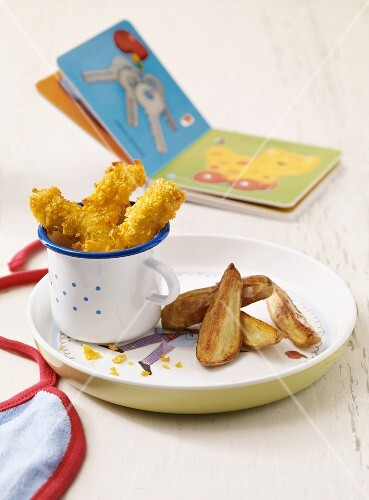 Breaded chicken goujons with potato wedges as baby food