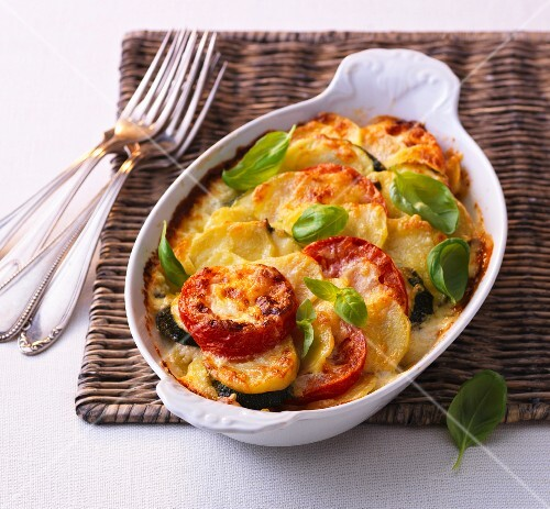 Courgette and potato bake with tomatoes and basil