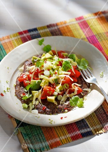 Tex-Mex waffles made from black beans and potatoes with vegetables and grated cheese