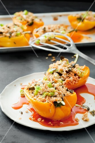 Peppers filled with couscous, spring onions and dried tomatoes