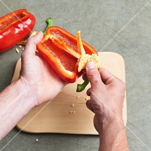 Stem being removed from a pepper