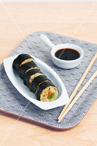 Maki sushi with vegetables and soy sauce