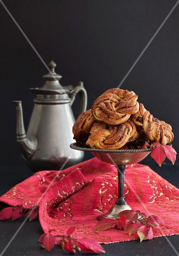 Chocolate and cinnamon buns on a pewter stand