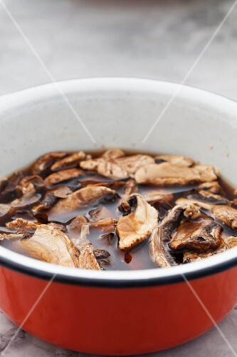 Dried mushrooms being soaked