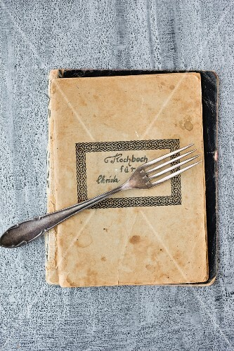 A fork on an old recipe book