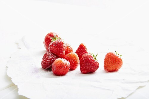 Strawberries on white paper