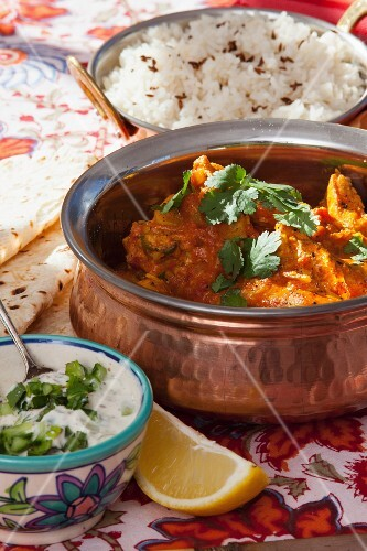 Chicken curry with ginger and coriander served with yogurt sauce and rice
