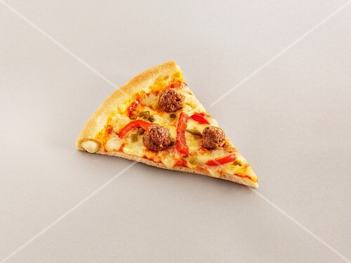 A slice of stuffed crust pizza with meatballs and peppers