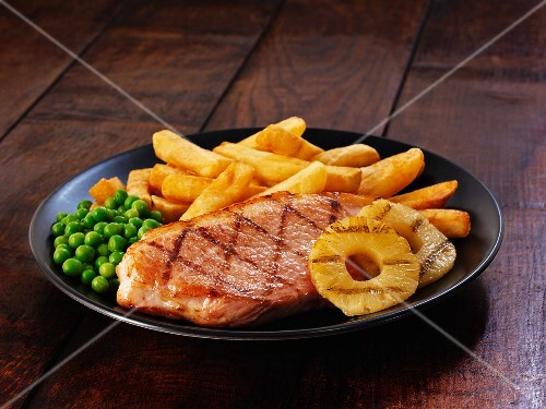 Ham steak with pineapple and chips