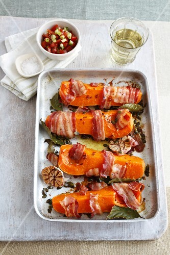 Roast butternut squash wedges with bacon