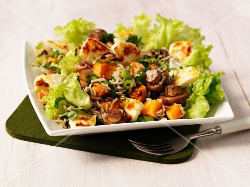 Rice salad with fried mushrooms and pumpkin